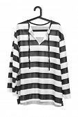 stock photo of prison uniform  - A studio shot of a black and white striped prison uniform on a hanger isolated against white background - JPG