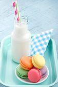 foto of french pastry  - Vintage setting of colorful pastel macaroons and milk in a bottle with striped straws - JPG