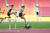 MOSCOW - JUN 11: Serial shot athlete makes a good jump on International athletic competition Moscow