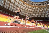 MOSCOW - JUN 11: Female athlete running in the stadium on International athletic competition Moscow