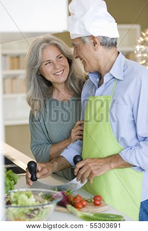 Happy senior couple cooking healthy food