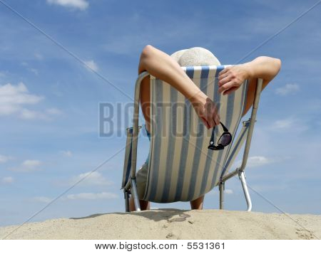 Woman Sunbathing On The Beach