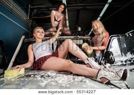 Sexy women washing car