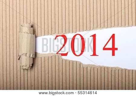Happy New Year 2014 On Torn Cardbox