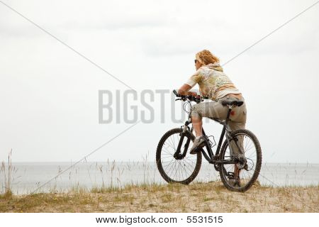 Young Women With Bicycle
