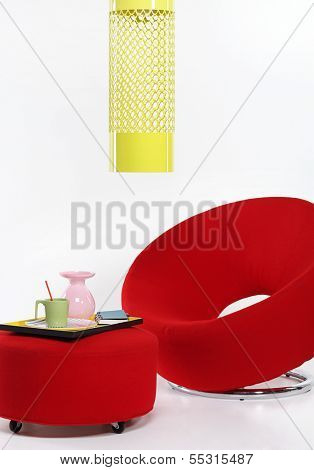 Modern red chair and a coffee table