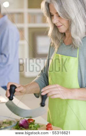 Senior woman cooking healthy food