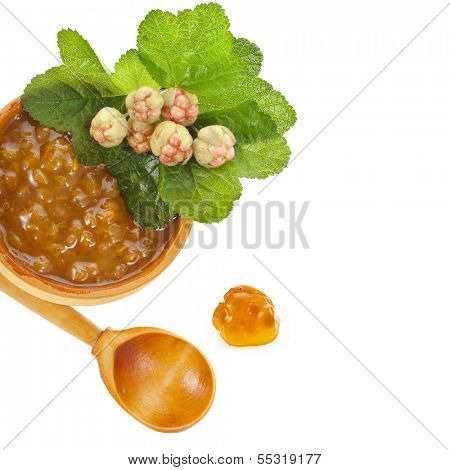 cloudberry jam bowl with fresh berry close up isolated on white background