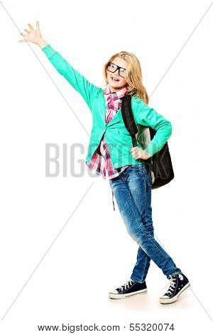 Cute ten years girl standing with her schoolbag. Isolated over white.