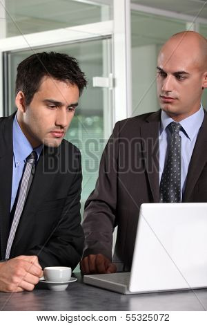 Young businessman looking sad
