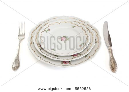 Dinner Set With Three Plates Knife And Fork Isolated