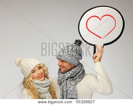 winter, relationships and happiness concept - family couple with blank text bubble