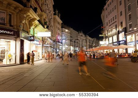 Tourists walk at night in center of Vienna