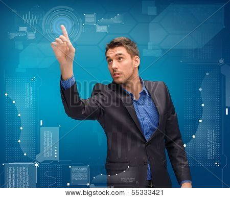 business, technology, communication concept - businessman working with imaginary virtual screen