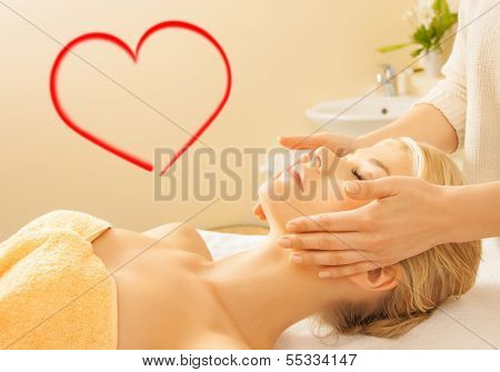 spa, beauty, resort and relaxation concept - close up of woman in spa salon getting face treatment