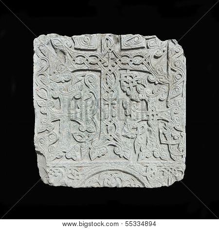 Armenian medieval cross stone  isolated on black