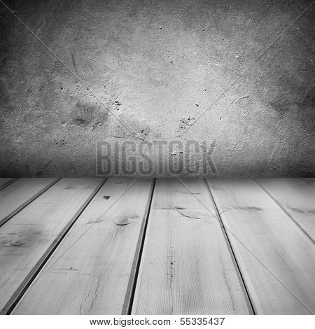 Wooden floorboards and concrete wall