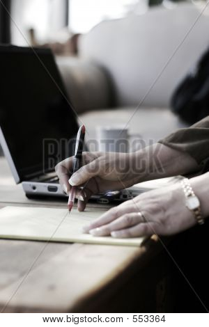 Businesswoman, Notes, Laptop, & Hotel Atrium