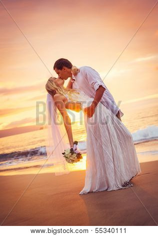 Bride and Groom, Kissing at Sunset on a Beautiful Tropical Beach, Romantic Married Couple