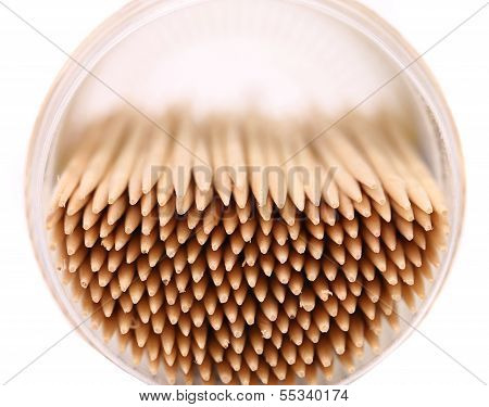 toothpicks in a round box, top view