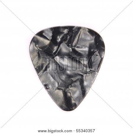 Dark plastic guitar plectrum