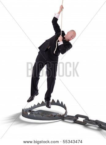Businessman Hanging On Rope