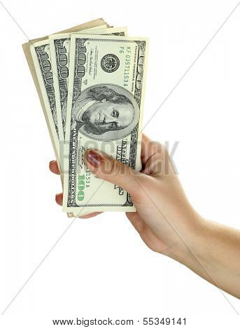 Female hand with dollars close up isolated on white