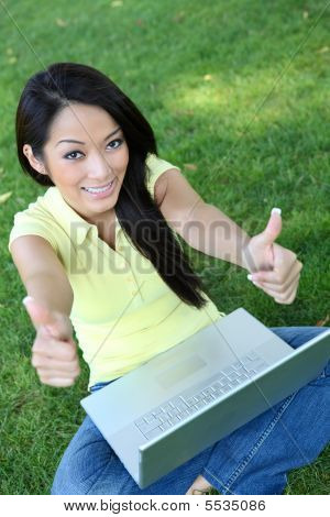 Asian Woman On Laptop Computer