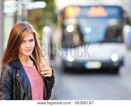 Attractive girl at the bus stop