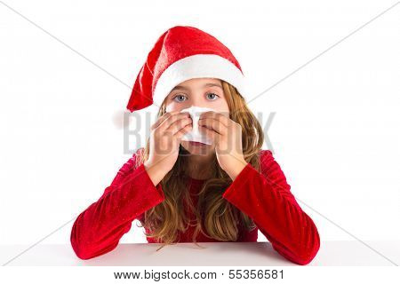 Christmas Santa kid girl blowing her nose in a winter cold isolated on white background
