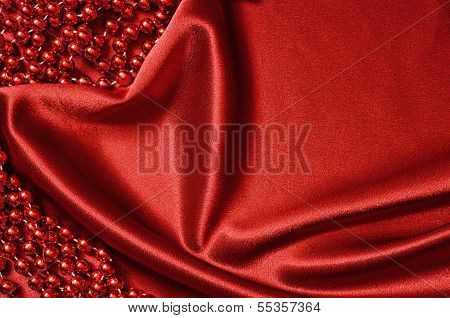 Red Satin Drapery And Beads