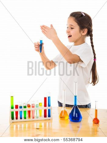 girl sniffs a chemical reagent