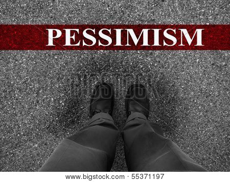 Businessman standing on asphalt starting line with word pessimism