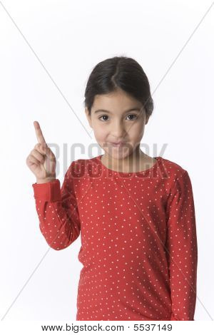 Little Girl Is Raising Her Finger With A Shy Expression
