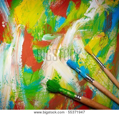 Paintbrushes on abstract grange background