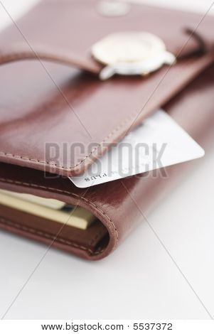 Credit Card And A Watch On A Agenda