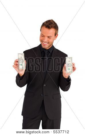 Smiling Businessman Looking At Money