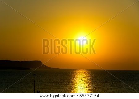 Sunset over sea , Cyprus, Ayia Napa , with reflection