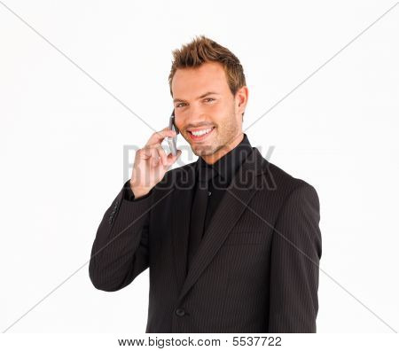 Smiling Male Business Manager On The Phone