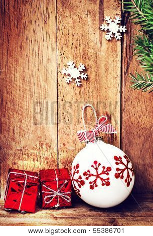 Old Fashioned Christmas Ornaments  Over Wooden Background  With Fir Tree Branch And Festive Decorati