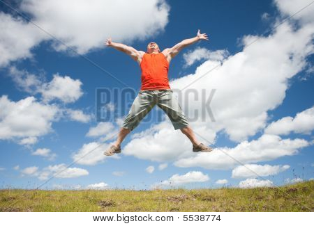 Man Jumping For Joy Outdoors