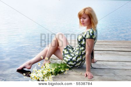 Woman With Daisies On The Pier