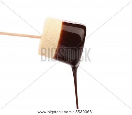 Marshmallow in chocolate syrop. Isolated.