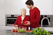 pic of grandma  - Grandma and young granson enjoy cooking together - JPG