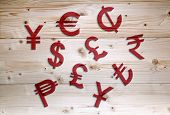 stock photo of lira  - International red economy currency units on wooden background - JPG