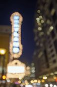stock photo of marquee  - Old Historic Theater Marquee on Broadway Portland Oregon Downtown at Evening Blue Hour with Blurred Defocused Bokeh Blinking Lights - JPG