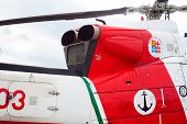 picture of attack helicopter  - Side view of a helicopter on the ground - JPG