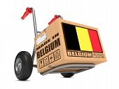 picture of free-trade  - Cardboard Box with Flag of Belgium and Made in Belgium Slogan on Hand Truck White Background - JPG
