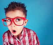 image of nerd glasses  - Surprised five years old boy wearing glasses - JPG