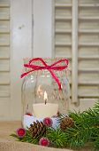 stock photo of masonic  - Holiday candle in mason jar with bow and pine - JPG